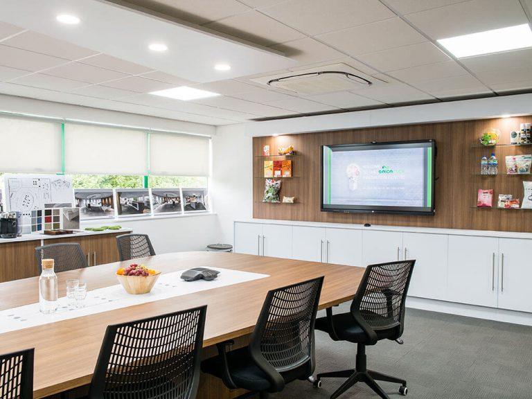 Americk Packaging revamped meeting room interior - desk area
